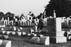 Tony_Ward_photography_early_work_1970's_Lancaster_Pa_graveyard_children_playing_on_tombstones_jumping