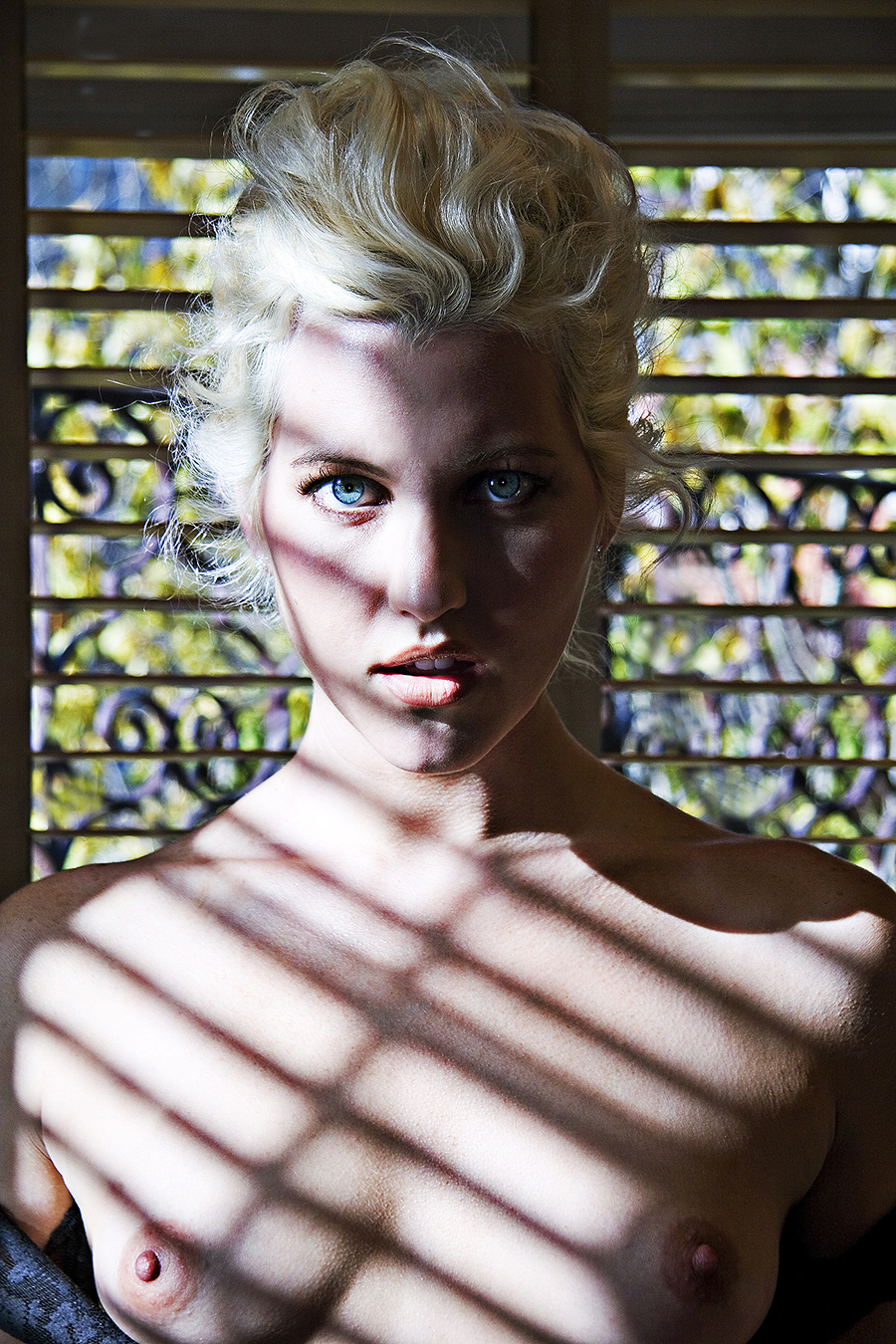 Tony_Ward_erotic_fashion_photography_blue_eyed_blonde_topless_chirascuro_light