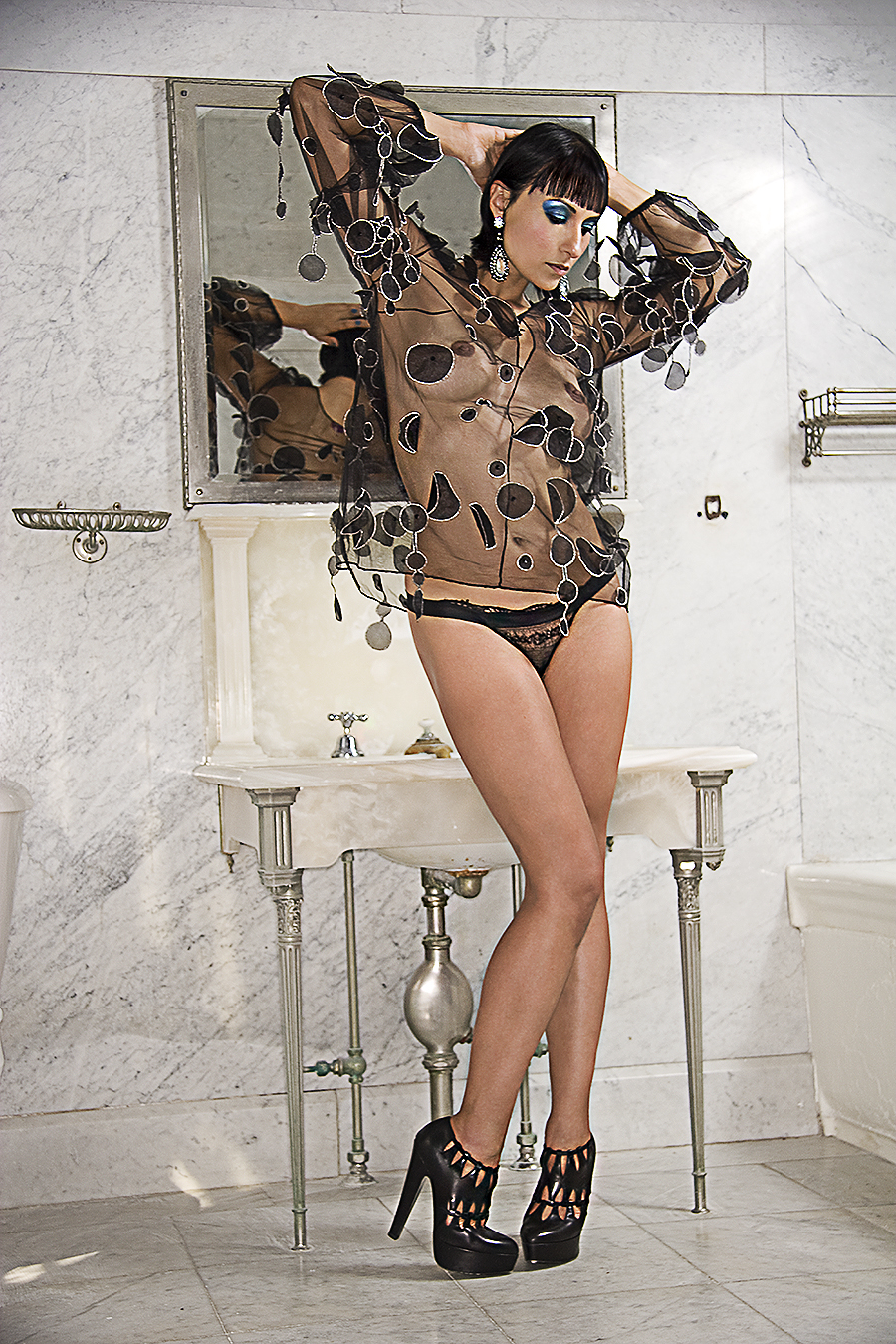 Tony_Ward_fashion_photography_bare_breasts_ethnic_sexy_women_red_lace_sheer_dress_black_fishnet_shoes_blue_eye_shadow_large_marble_bathrooms_elegance_fireplaces_chandeliers_old_mansions_Elkins_Park_estates_model_Carmelita_Martel copy