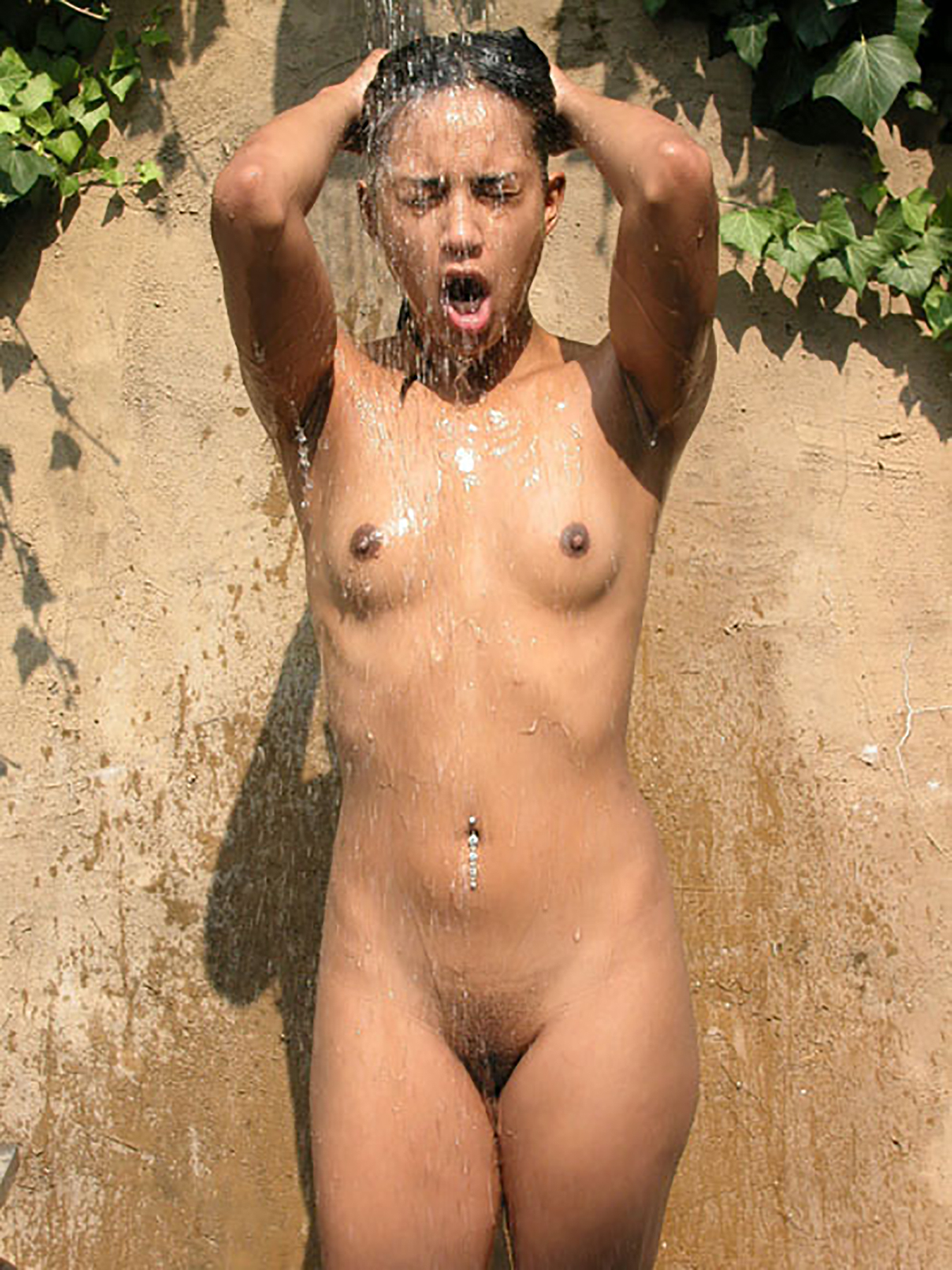 Hannah_frontal_nude_eyes_closed_dreamy_August_2003_bathing_outdoors_cold_shower