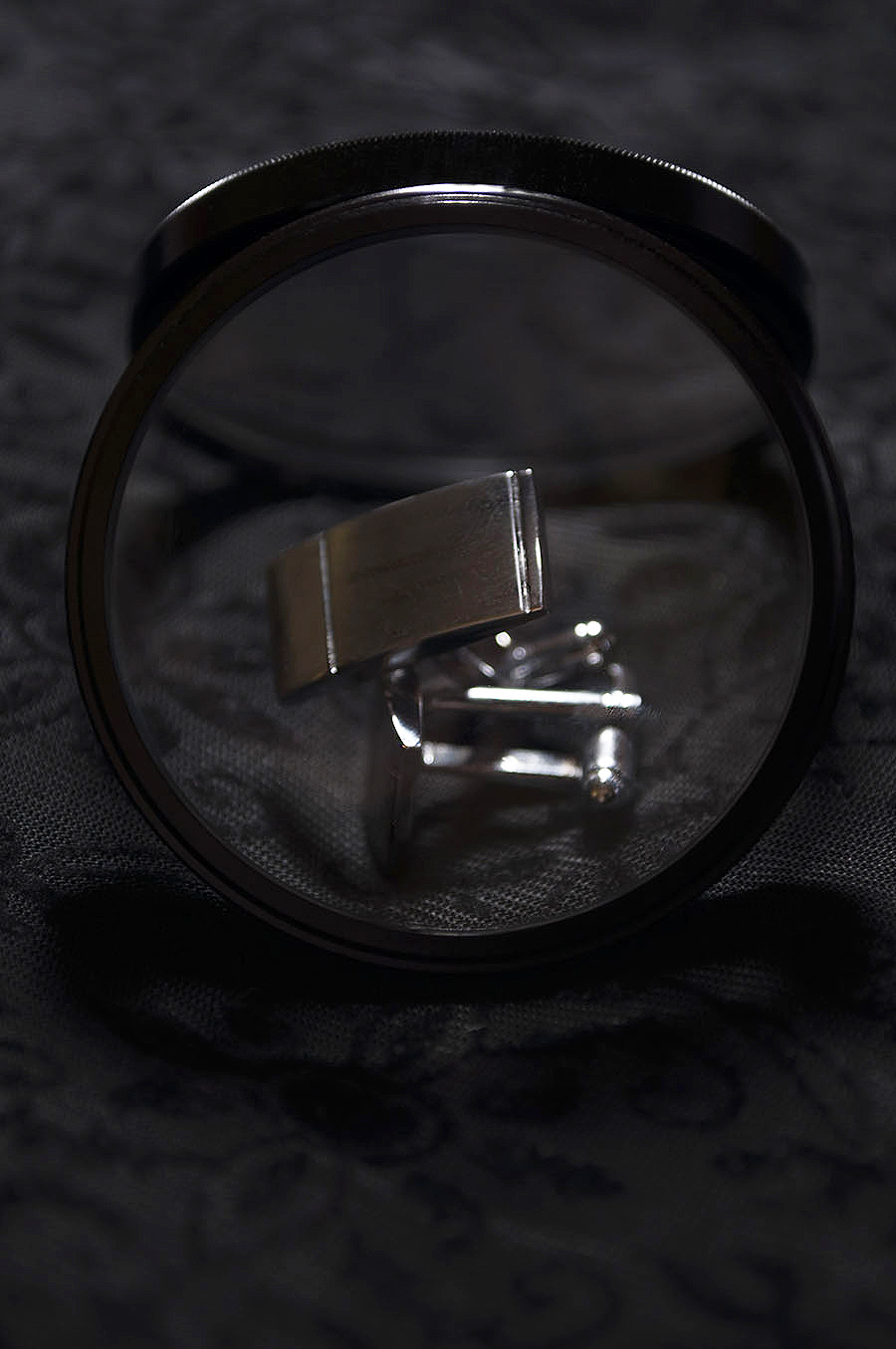 Rebecca_Huang_student_photography_still_life_accessories_cuff_links_silver_minimal_lens_magnifying_black_velvet_floral_dark