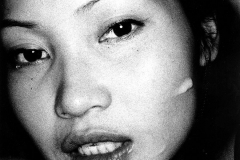 med-Tony_Ward_photography_documentary_wasteland_party_amsterdam_netherlands_facial_asian_woman_submissive