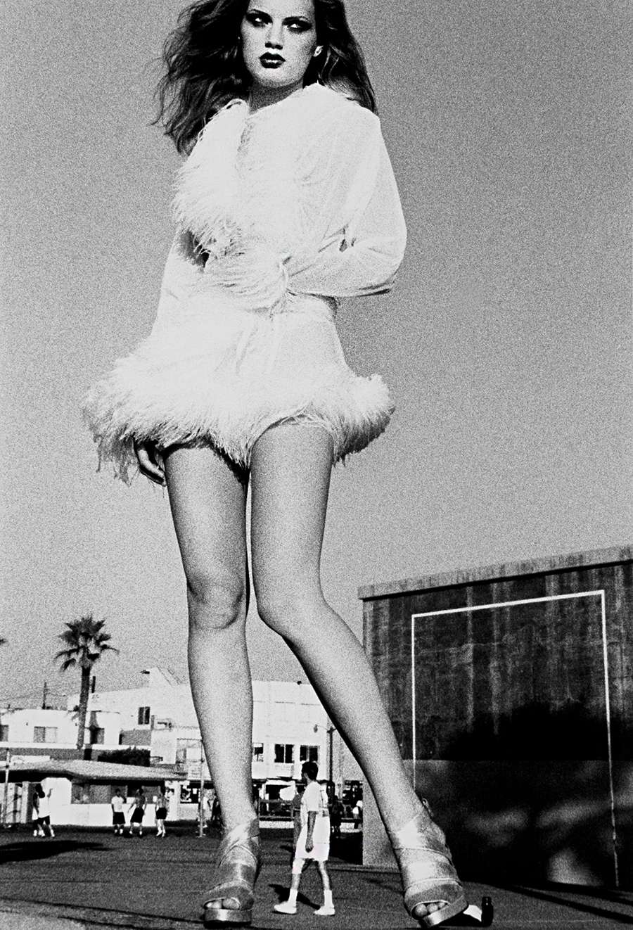Tony_Ward_early_work_portfolio_classics_nudes_1990's_rooftop_vintage_hat_model_famous_models_Los_Angeles_santa_monica_view_obsessions_Venice_Beach_boa_feathers