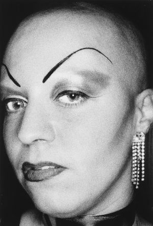 Tony_Ward_Photography_early_90's_portraits_star_ring_light_sexy_girls_dominatrix_Hamburg_Germany_fake_brows_glamorous_earrings.jpg