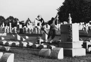 Tony_Ward_Photography_early_work_kids_playing_cemetary_lancaster_pennsylvania_1976_tombstones.jpg