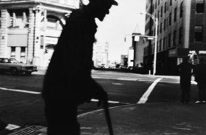 Tony_Ward_photography_early_work_1970's_rochester_New_york_silhouette_man_cane_beard_street_photography.jpg