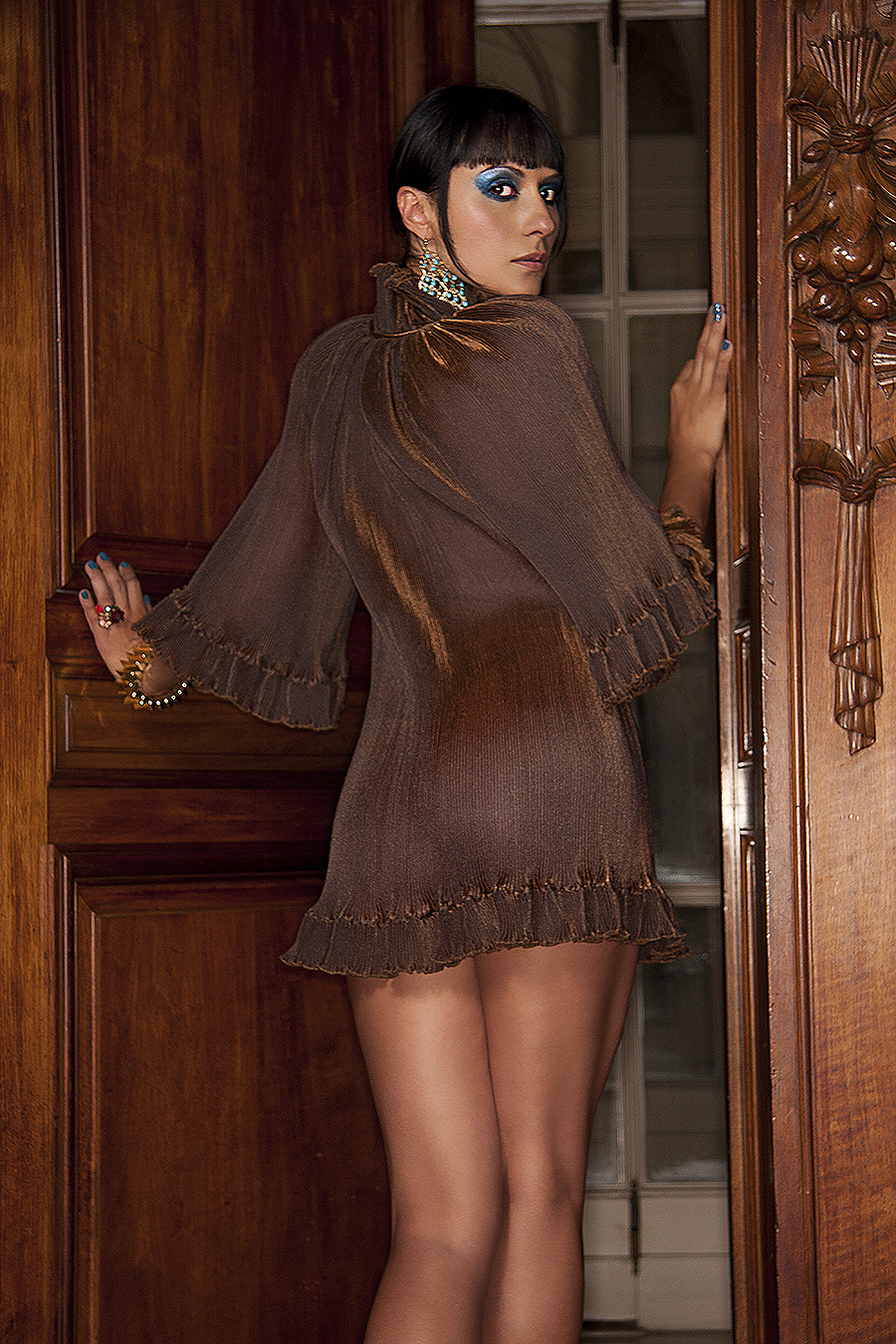 Tony_Ward_fashion_photography_brown_lace_sheer_dress_wood_platform_shoes_blue_eye_shadow_large_rings_elegant_fireplaces_chandeliers_old_mansions_Elkins_Park_estates_model_Carmelita_Martel copy